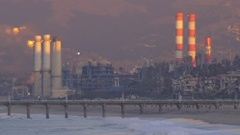 The sun rises on a power generating station. Stock Footage