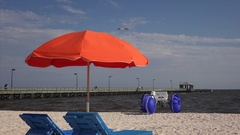 Lounge Chairs and Beach Umbrella Along Mississippi Gulf Coast in Biloxi Stock Footage