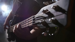 Top view. Grief and string electric bass guitar. Slow motion Stock Footage