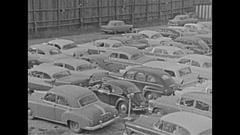 Vintage 16mm film, 1959 jam packed full parking lot, pan Stock Footage