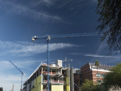 Time lapse of tower cranes in operation at a construction site Stock Footage