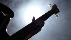 Play musician on four strings bass guitar. Closeup. Slow motion Stock Footage