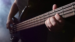 Slow motion. Grief and string electric bass guitar. Top view Stock Footage