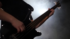 Slow motion. Play musician on four strings bass guitar. Closeup Stock Footage