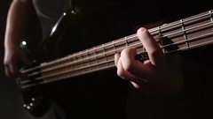 Closeup. Grief and string electric bass guitar. Slow motion Stock Footage