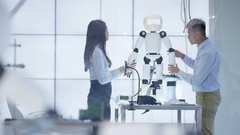 4K Technical engineers working on construction of automated robot in modern lab. Stock Footage