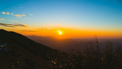 4K time lapse morning sunrise with moutain Stock Footage