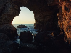 The Arch - rock formation near Tyulenovo and the sea. Sunrise shot Stock Footage