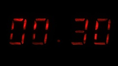 Digital clock shows the time of 59 minutes 40 seconds to 00 minutes 10 seconds Stock Footage