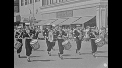 Vintage 16mm film, 1959 Sea cadet band marching in parade through town Stock Footage