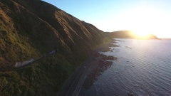 Aerial view of scenic coastal highway at sunset Stock Footage