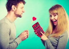Woman making calculation of relationship. Stock Photos