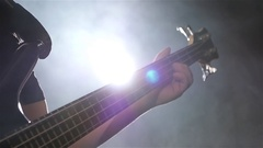 Closeup. Slow motion. Play musician on four strings bass guitar Stock Footage