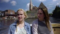 Adventurous Young Women Enjoy A Boat Tour Through The Canals Of Bruges, Belgium Stock Footage