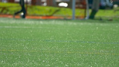 Detail of a turf soccer football field, slow motion. Stock Footage