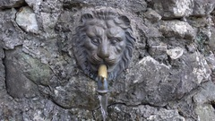 Water flowing from a stone lione fountain Stock Footage
