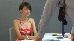 Beautiful girl in handcuffs, is suspected of committing a crime Stock Footage