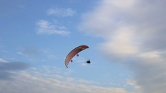Paramotor flying in the sky Stock Footage