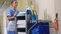 Hotel Housemaid Changing Towels in Room Stock Footage