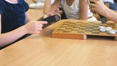 Little girls playing checkers at the garden Stock Footage