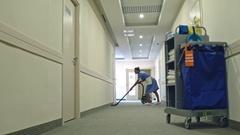 Chambermaid Vacuuming Hotel Hall Stock Footage