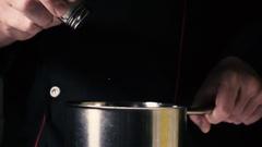 Slow mo chef adds salt salt shaker Stock Footage