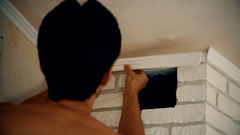 Craftsman mounting a polyurethane ceiling molding Stock Footage