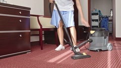 Cleaning Lady Vacuuming Room Stock Footage