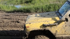 4×4 car is trying to cross the muddy area Stock Footage