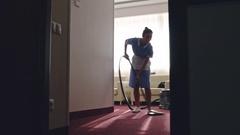 Chambermaid Vacuuming Hotel Room Stock Footage