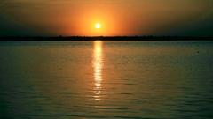 Beautiful sunrise or sunset above sea with sun path Stock Footage