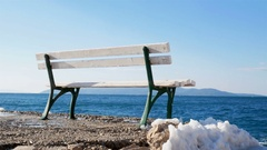 Bench by the blue sea on winter time Stock Footage