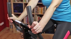 Woman cycling on bike trainer closeup Stock Footage