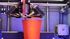 3d printer printing red round model Stock Footage