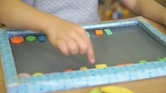 Pupil learning counting with colors and shapes Stock Footage