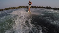 A man wakeboarding behind a boat, slow motion. Stock Footage