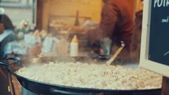 Prague, Czech Republic - December 24,2016: Delicious tasty street food on a pan Stock Footage
