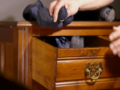 Socks being put into an old chest of drawers. Stock Footage