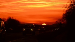 Time lapse traffic on A64 dual carriageway at sunset york uk Stock Footage