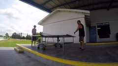Two men playing table tennis ping pong. Stock Footage
