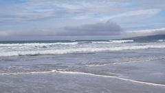 Tar Blob Beach Oil Spill Petroleum Tilt Down From Ocean 4k Stock Footage