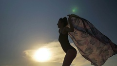 Smiling woman dancing with a scarf in swimming suit in slow motion Stock Footage