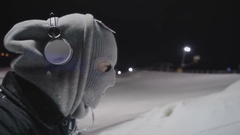 Skier in the mask goes on a lift Stock Footage