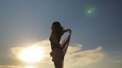Beautiful female dancing and holding a transparent scarf on the beach in sl.. Stock Footage
