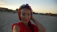 Female girl taking selfie in vacation on the beach at sunrise Stock Footage