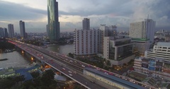 Bridge Over Chao Phraya River in Bangkok at Dusk, Ascending Pullback Drone Shot Stock Footage