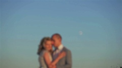 Man and woman blurred stand embracing at moon in sky background Stock Footage