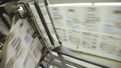 Rotation of conveyor belt of printed products in plant Stock Footage