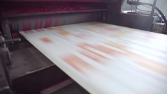 Printed red color on printing machine to make newspaper in factory Stock Footage