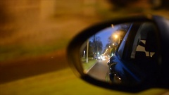 Night driving on road, wing mirror detail Arkistovideo